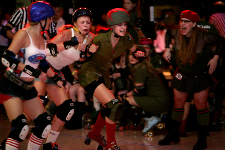 Meghan Kapousouz, aka Meg MyDay, takes ontwo skatersfrom the Honky Tonk Heartbreakers asAlyssa Hoppe (Captain Lorna Boom), right, shouts encouragement in Austin, Texas.