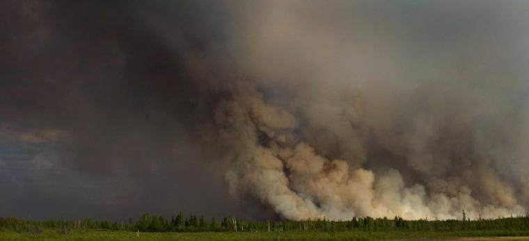 The Tamarack Fire burns outside Nenana, Alaska, along the Parks Highway on Thursday.