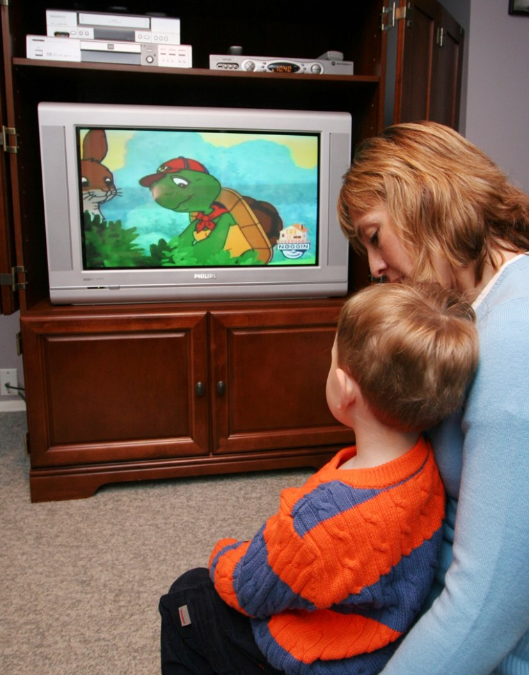 Lisa Donohue and her son Calum, 2, watch cartoons at their home in Massapequa Park, N.Y. The Donohues television signal comes to the house over a fiber optic cable installed recently by the Verizon phone company. Verizon is making a big bet that the time is right to replace its copper phone lines with optical fiber.