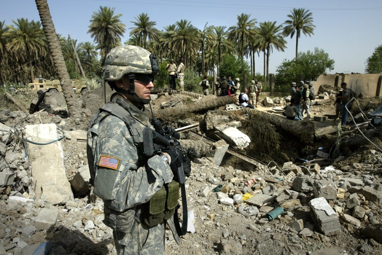 A U.S. 4th Infantry Division soldier guards the scene of the recent airstrike against Abu Musab al-Zarqawion the outskirts of Hibhib, near Baqouba, Iraq, onSaturday.
