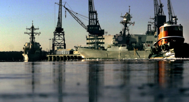 Navy ships are seen at the Bath Iron Works shipyard along the Kennebec River in Bath, Maine.