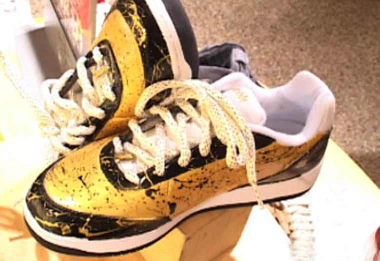 Each of the 60 limited-edition black-and-gold 'Finals Shoe' is individually spray painted and has an image of the NBA trophy on the undersole.