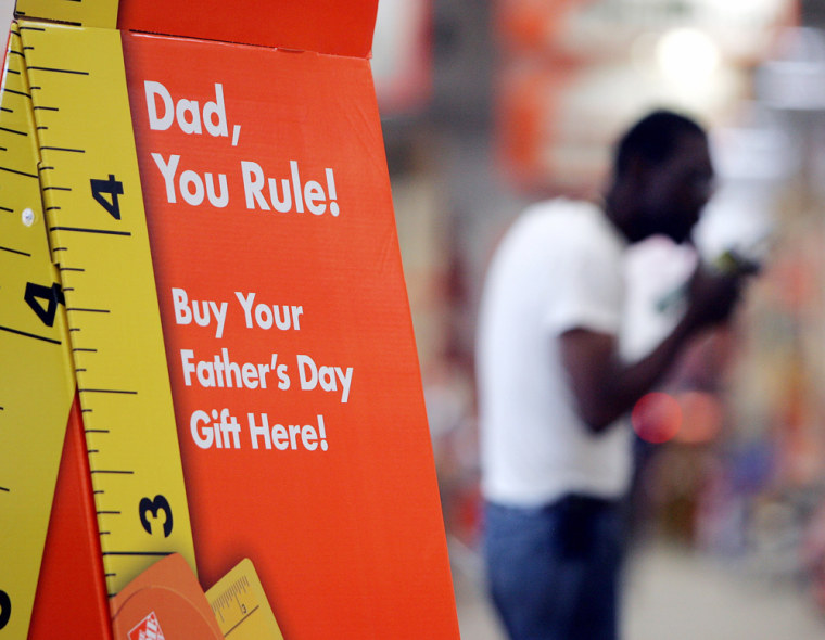 A sign advertises Father's Day gifts at a Home Depot store in Atlanta this month. The home improvement giant is among retailers placing more emphasis on Father's Day this year.