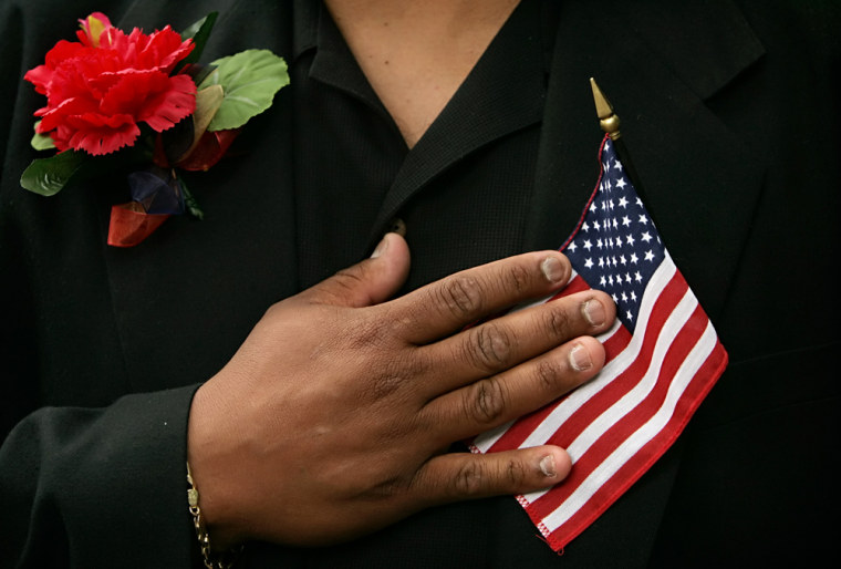 Juan Alfaro, who immigrated from Honduras, recites the Pledge of Allegiance after taking the oath of citizenship at the Betsy Ross House during a Flag Day and naturalization ceremony in Philadelphia on Wednesday.