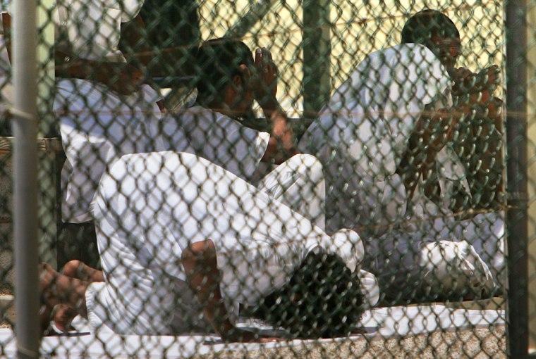 Inmates of the Camp Delta detention center pray this past Aprilat the Guantanamo Bay U.S. Naval Base, Cuba.