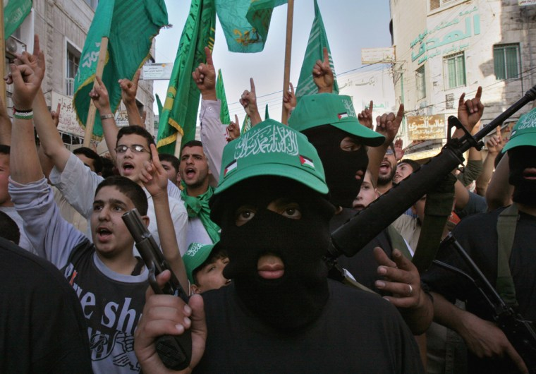 Hamas militants demonstrate Tuesday in Nablus. They were protesting Monday night's riots in another West Bank city, Ramallah,in which the the parliament building and cabinet offices in Ramallah were shot at and set ablaze.