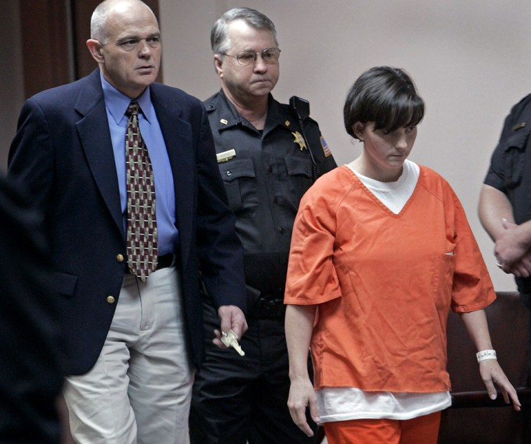 Winkler is followed to her seat by McNairy County Sherriff Roten and bailiff Bivens while entering courtroom in Selmer