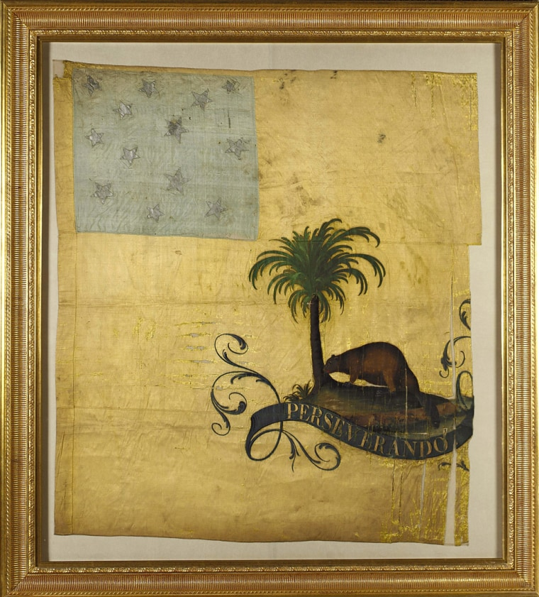 """Thisbattle flag, known as """"Perseverando,"""" was one of four from the American Revolutionwere auctionedtogether Wednesday by Sotheby's in New York for more than $17 million."""