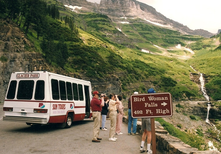 Visitors stop on Going-to-the-Sun Road to look at Bird Woman Falls.