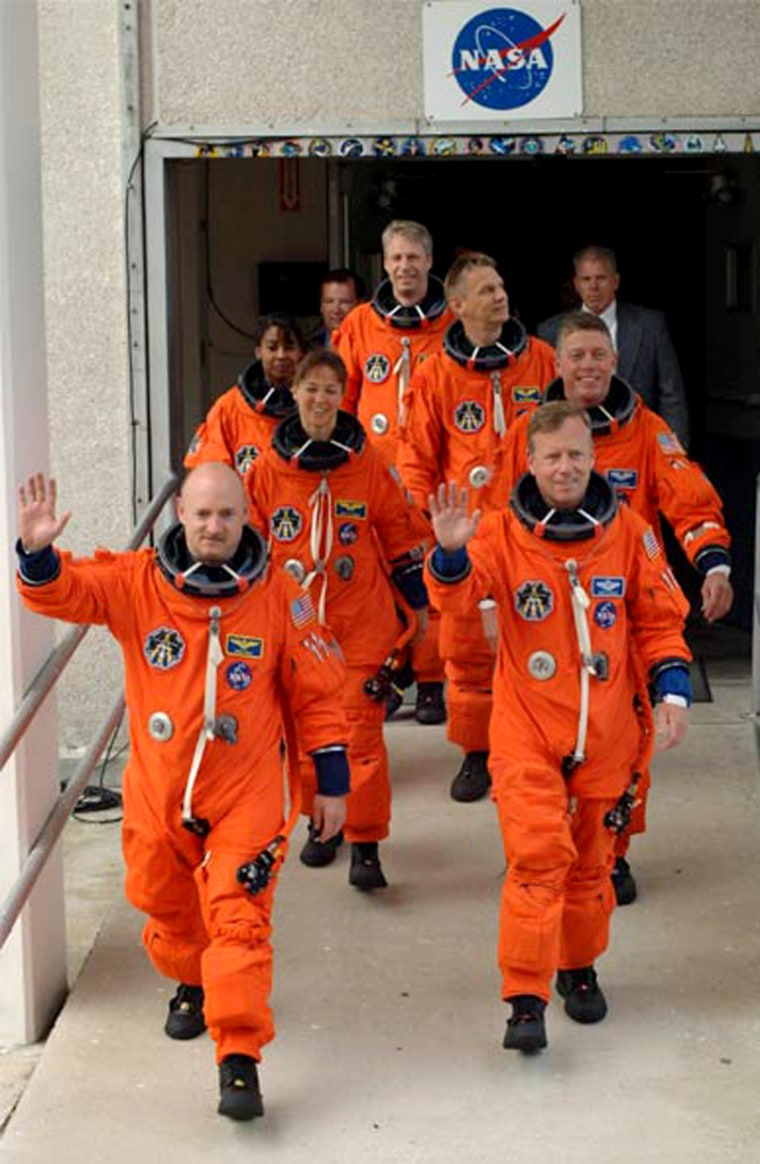 Discovery's astronauts walk out from their quarters for a trip to the launch pad on Thursday, kicking off a countdown rehearsal at NASA's Kennedy Space Center. Clockwise from bottom left: pilot Mark Kelly, Lisa Nowak, Stephanie Wilson, German astronaut Thomas Reiter, British-American astronaut Piers Sellers, Mike Fossum and commander Steve Lindsey.