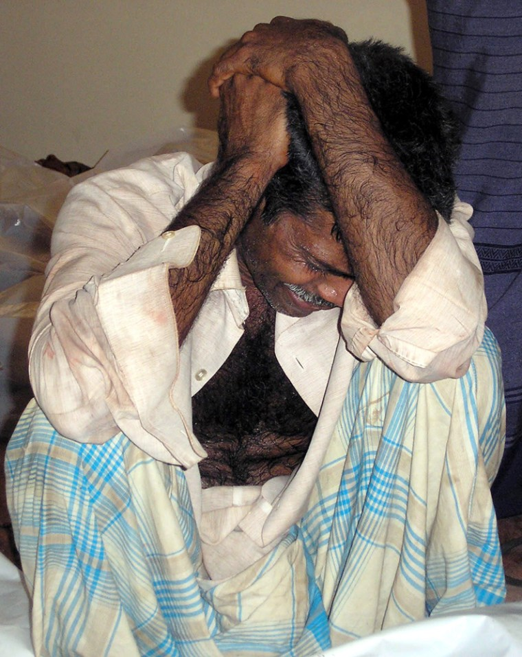 Senaratne weeps near the bodies of relatives killed in a landmine blast at a hospital in Kabithigollewa, about 131 miles northeast of Colombo, Sri Lanka, on Thursday.