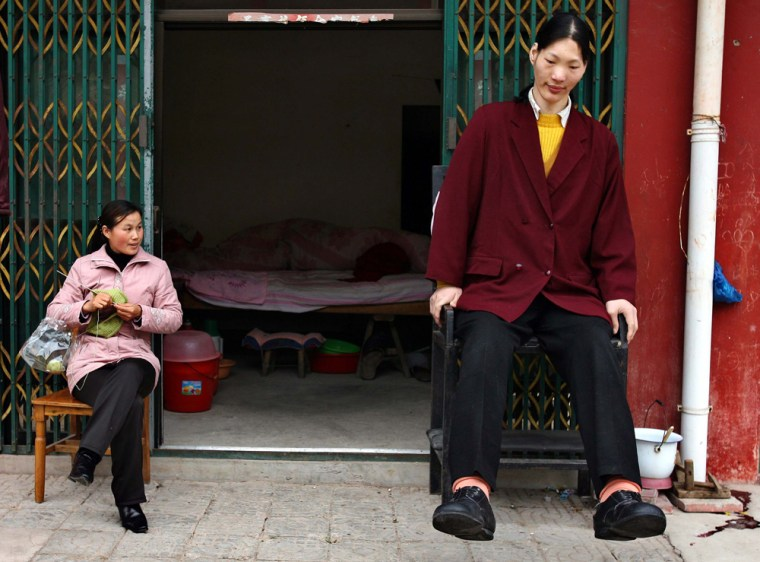 Tallest woman in Asia and her friend sit in Shu Cha in eastern China's Anhui province