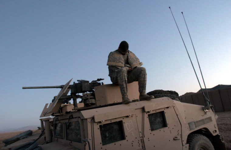 A U.S. soldier rests before heading out in a military convoy at a base outside the village of Musa Qala, Helmand Province, south Afghanistan, early Friday morning.