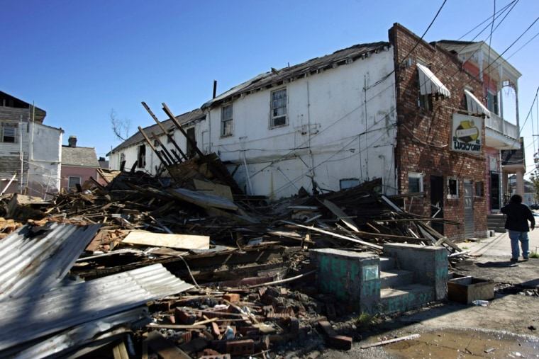 A damaged building sits among debris on St. Bernard Avenue in New Orleans