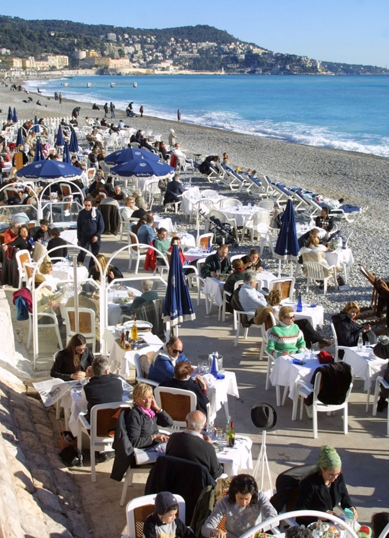 People take lunch at the Blue Beach restaurant in Nice,France.