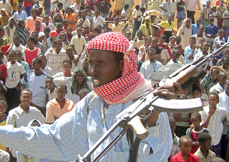 A militiaman from the Islamic Courts Union keep an eye on the crowd in Mogadishu during a protest against proposed foreign peacekeeping missions, Thursday.