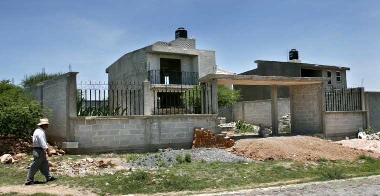 The majority of the new houses being built in Boye, Mexico, come from Mexicans north of the border working multiple jobs and sending money home.