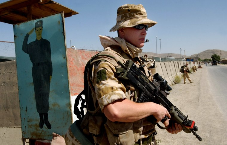 Britain's Royal Marine Commandos, part of NATO- led forces, are seen during a foot patrolling mission in Kabul, Afghanistan Monday.With OperationMountain Thrust,forces have launched amajor offensive that has killed about 100 suspected insurgents in targeted operations in the past few days.