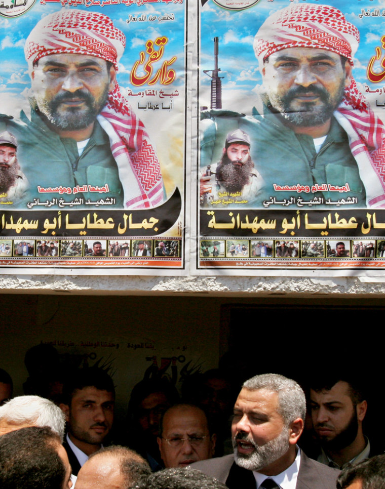 Palestinian Authority Prime Minister Ismail Haniyeh speaks to a group of government employees. Thousands of desperatecivilservants received about $300 in emergency payments Monday.