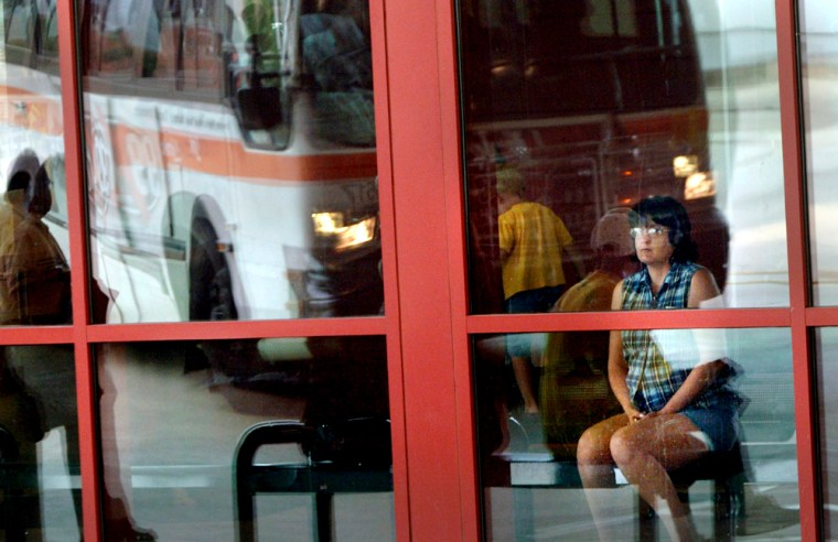 Passengers wait to board Citylink buses in Peoria, Ill. Ridership is up 15 percent in April for the city's bus system over the same time last year.
