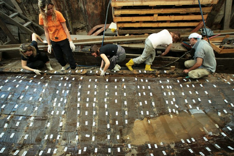 Turkish archaeologists and restorers work on remains of a tenth century Byzantinian ship in Istanbul