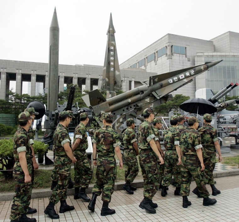 South Korean soldiers walk by displays of models of North Korea's Scud-B missile, left, and other South Korean missiles at the Korea War Memorial Museum in Seoul, South Korea, on Wednesday.