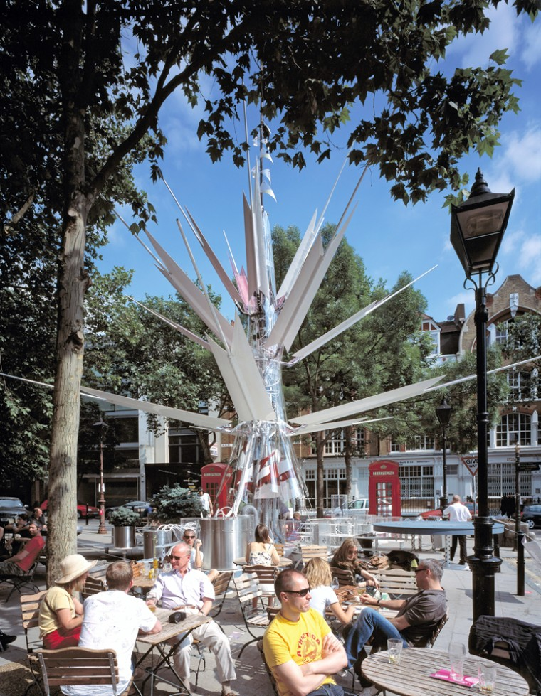 LondonOasis, a sculpture with a wind turbine on top and solar panels on its branches, has been installed in a London square.