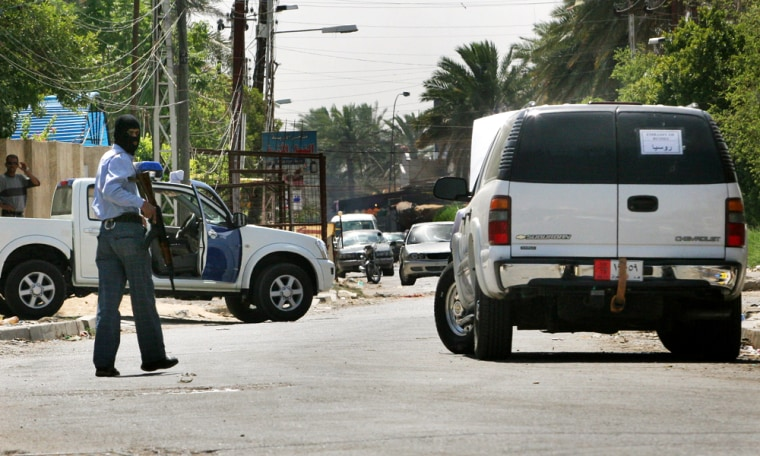 An Iraqi policeman patrols near a Russian diplomatic vehicle which was attacked in Baghdad earlier this month, resultingin a Russian diplomat being killed and four diplomatic employees being kidnapped.