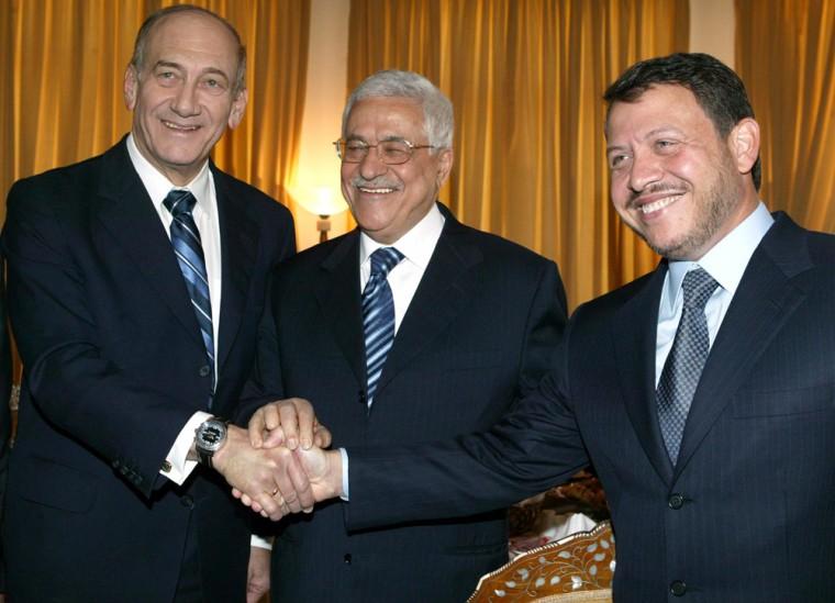 King Abdullah of Jordan shake hands with Palestinian President Abbas and Israeli MP Olmert in Petra
