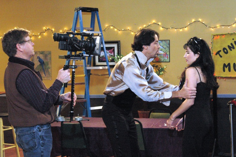 """A scene from the making of """"Nuestro Barrio"""" or """"Our Neighborhood"""" in a Durham, N.C. studio. The show teaches Latinos about the ways of the United Stateswhile entertaining them with traditional storylines revolving around love and betrayal."""