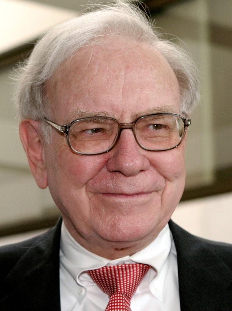 File photo of billionaire financier Warren Buffett meeting Senator Arlen Specter on Capitol Hill