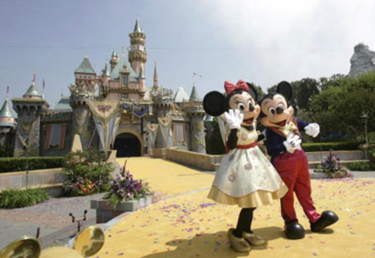 "Disneyland's famous residents, Mickey and Minnie Mouse. Anaheim, home to Disneyland, will soon become America's first ""wired"" city, offering wireless Web access for $22 a month."