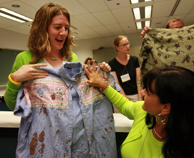 Teachers Jill Francis, left, of Flanagan, Ill., and Shelia Krotz, of San Diego, Calif., participating in a blood spatter analysis workshop during the Forensic Science Educational Conference.