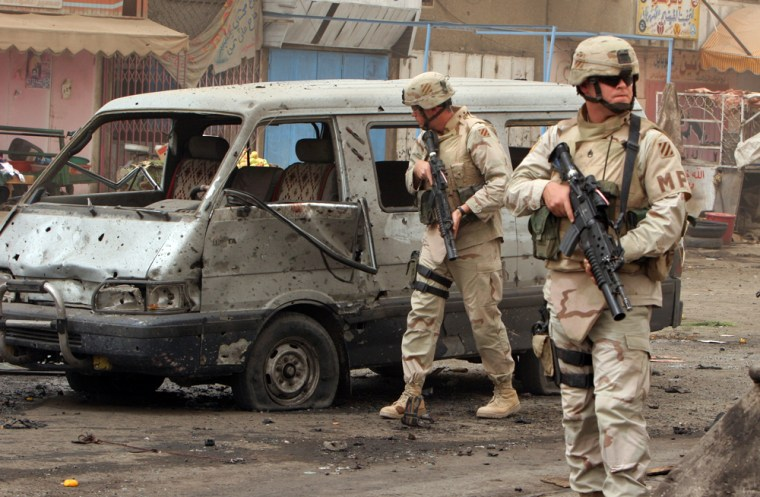 US SOLDIERS INSPECT SUICIDE CAR BOMB EXPLOSION