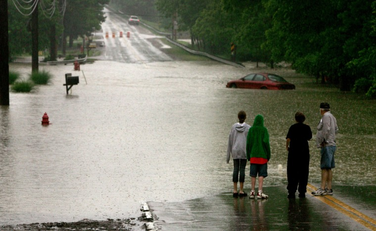 Flooding like this street in Bedford Heights, a Cleveland suburb, cut off areas across Ohio on Thursday.