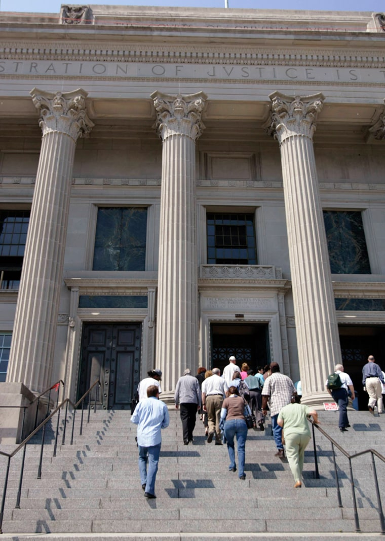 Members of a jury pool enter the criminal court building in New Orleans