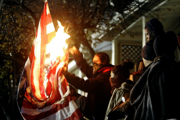 Protesters burn an American flag outside of San Quentin State prison in California — an act that could have been banned if the proposed constitutional amendment had been approved.