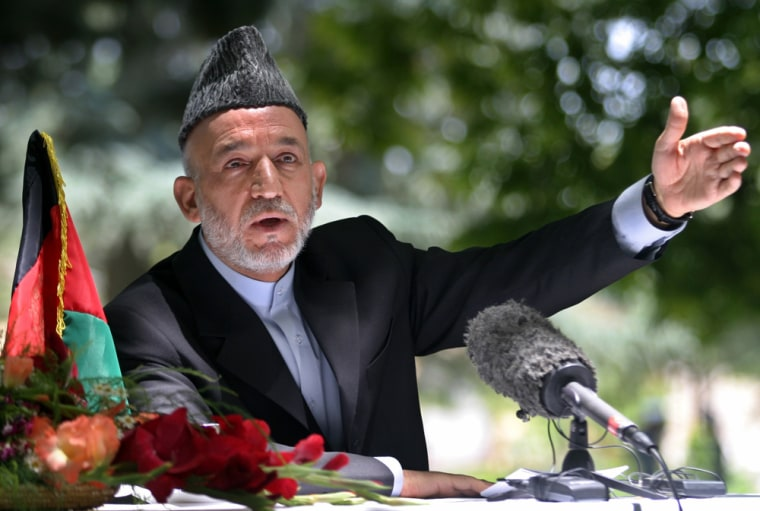 Afghan President Karzai gestures during news conference in Kabul
