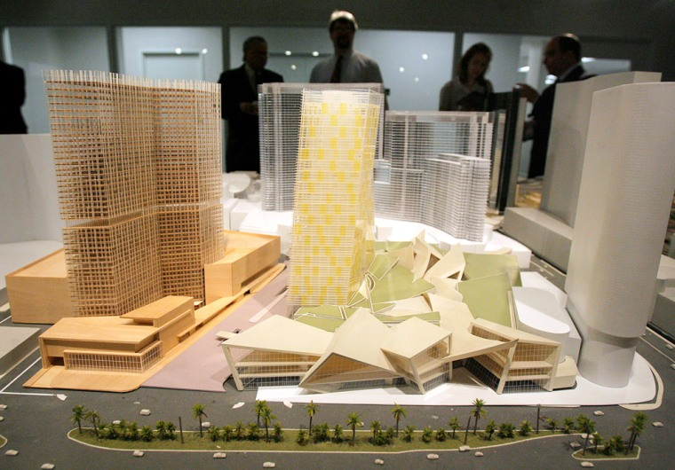 A model of Project CityCenter is shown at a news conference in Las Vegas on June 26. MGM chief executive Terry Lanni said the massive development, which is scheduled to open in late 2009, will create 7,000 construction jobs and 12,000 permanent positions.