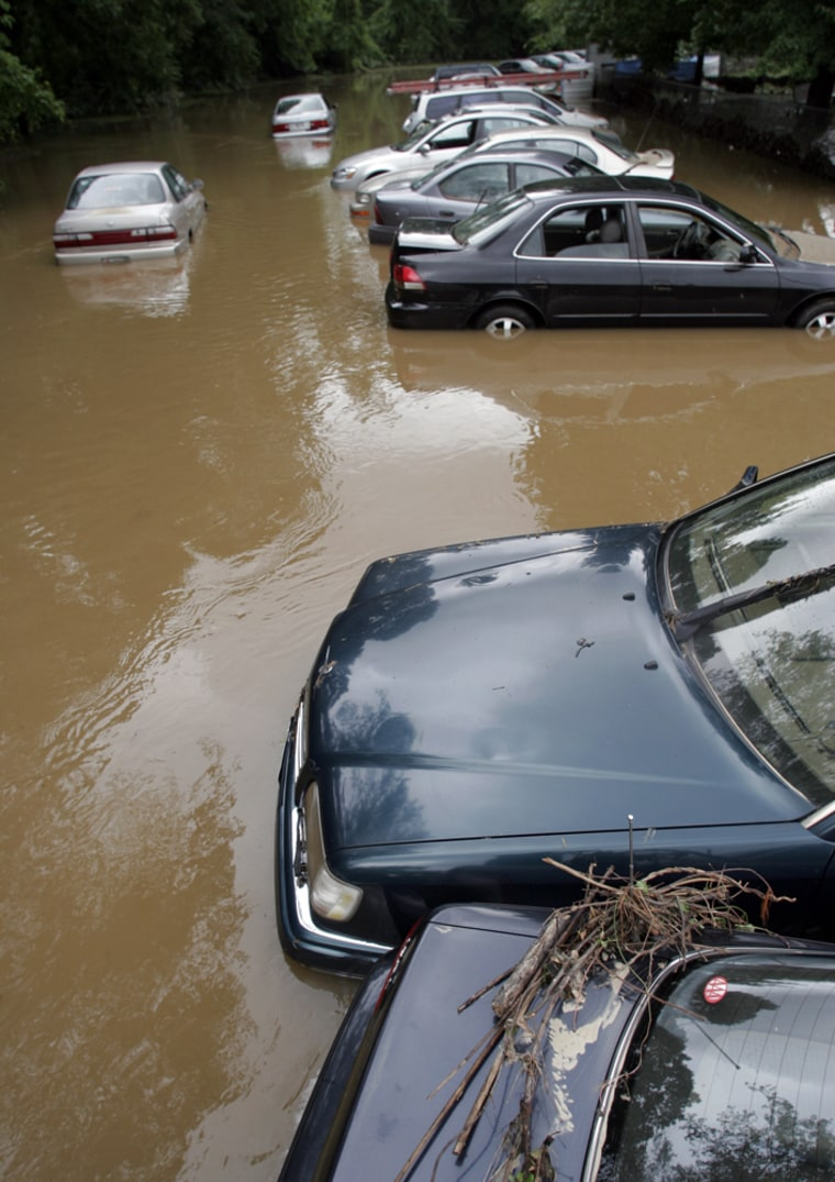Many areas in Washington, D.C., were under water on Monday, including this row of cars near Meadowbrook Park.