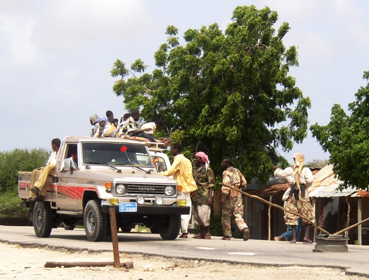 Members of the Islamic Courts Union search a truck at a checkpoint they took over from the Habar Gidir clan after a fire fight broke out between the two groups in Mogadishu, Somalia.