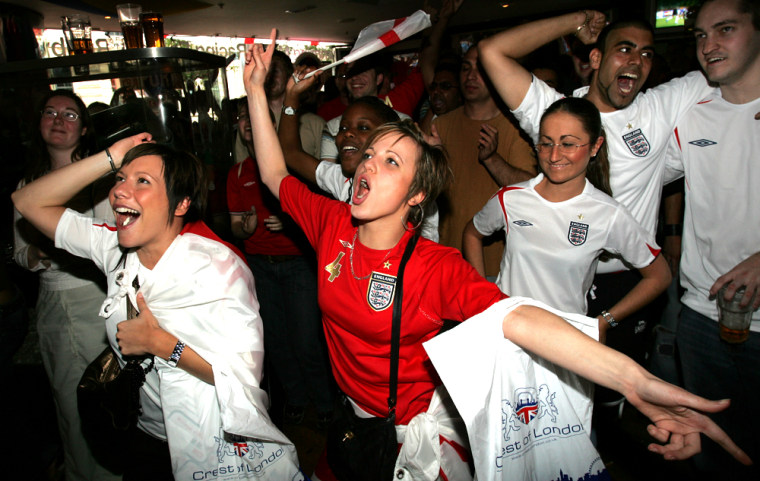 Some female England fans celebrate a David Beckham goal in a London Bar. For a recent match, 47 percent of English viewers were female.