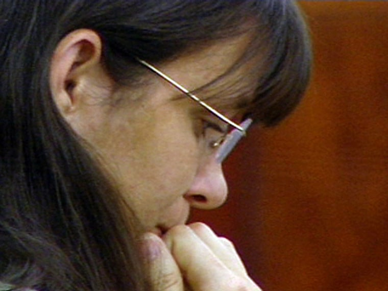 Andrea Yates listens to opening arguments in her second murder trial in this view from a courtroom television camera in Houston, Texas