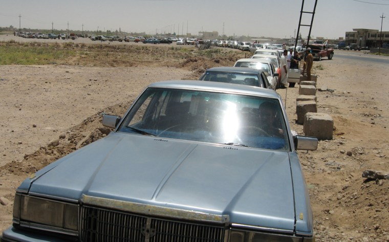 Motorists wait Thursday to buy fuelon the road outside a gas station near Iraq's largest oil refinery in Beiji, Iraq. Iraq have endued three years of attacks on oil pipelines. Three weeks ago the attacks stopped and U.S. commanders can't say why, but renewed oil sales are sending needed cash to Iraqi's government.