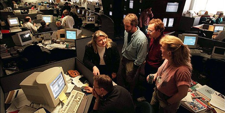 Business Editor Mark Pawlosky works at the computer surrounded by fellow employees, from left to right, Sandra Eisert, David Kaill, Brenden West and Breanna Anderson in the Redmond, Wash., newsroom shortly before the launch of MSNBC.com.