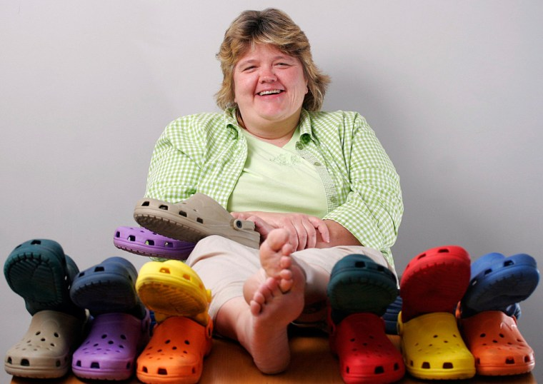 Jen Mosher poses with eight of her nine pairs of Croc shoes in Tuscaloosa, Ala. Mosher, a graduate student seeking her Ph.D. in biology from the University of Alabama, often wears the shoes because they are comfortable, fairly cheap and give good support.