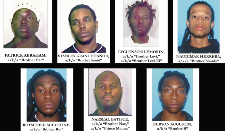 Handout photo provided by the U.S. Department of Justice shows seven people arrested in Miami