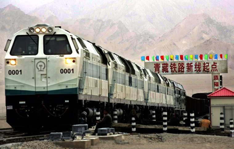 A train is seen near a board declaring the starting point of the Qinghai-Tibet railway at the Golmud Station in China's Qinghai province onJune 29.