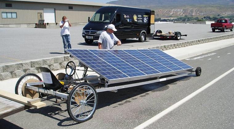 A Brooks Solar team member prepares its racer for the Solar Drag race.