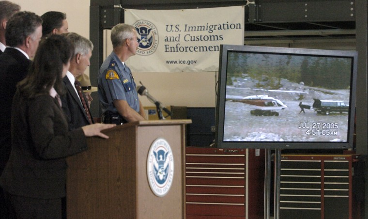 U.S. and Canadian law enforcement agencies show a video on Thursday of a drug smuggling operation on the U.S.-Canadian border in Bellingham, Wash. More than 40 people were arrested, authorities said.